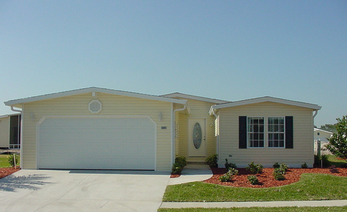 Exterior view of Jacobsen Homes manufactured home with garage