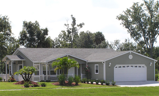 Exterior view of manufactured home with porch and garage