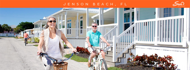 People riding bikes at Ocean Breeze modular home community in Jensen Beach Florida