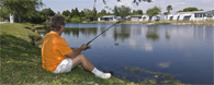 Fishing in the lake at Club Wildwood manufactured home community in Hudson Florida