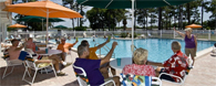 Residents enjoying a day by the pool at Club Wildwood manufactured home community in Hudson Florida