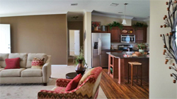 Living room and kitchen view at Jacobsen Homes of Lake City