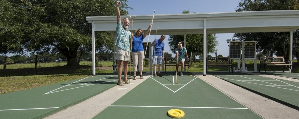 Playing Shuffleboard Oakview mobile home community in Arcdia Florida