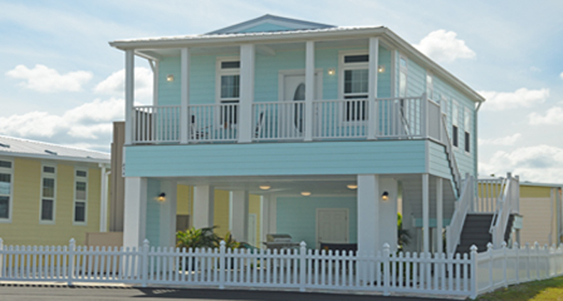 Home with a full front porch and on Stilts and recreational area under home