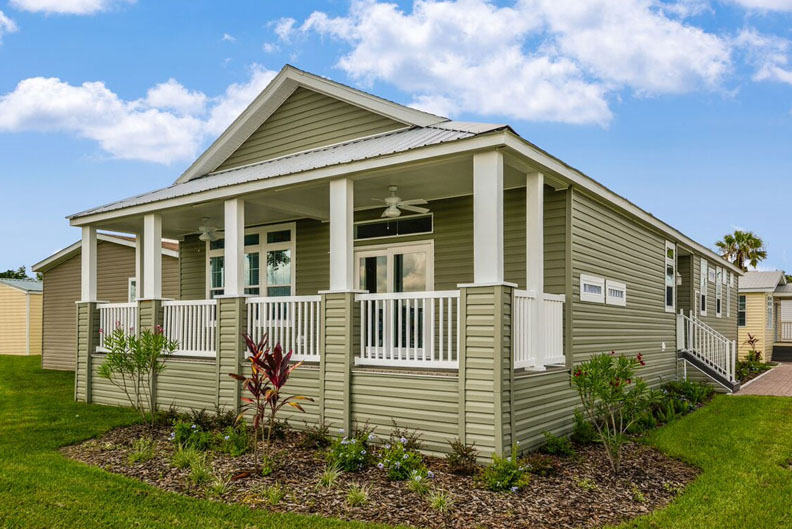Green Modular home with full front porch