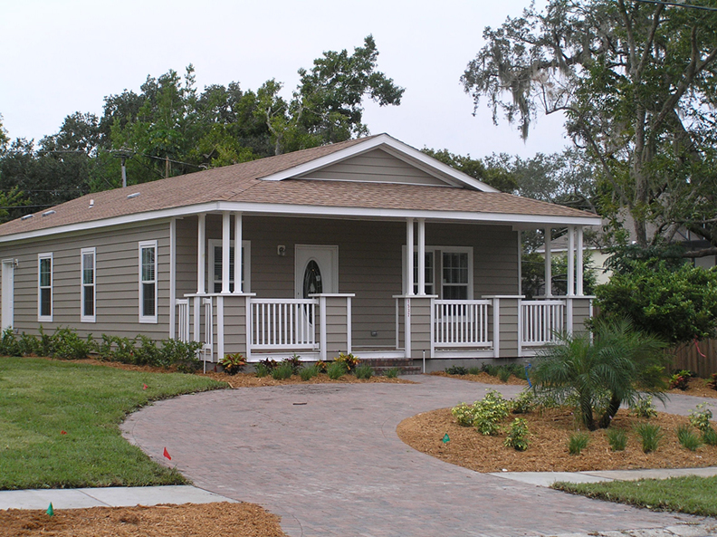 Modular home with front porch and circular drive