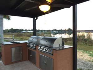 Lakefront outdoor grill at community clubhouse