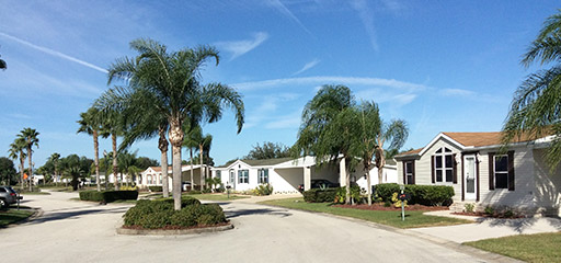 Manufactured home street scape at Palm Key Village manufactured home community in Davenport Florida