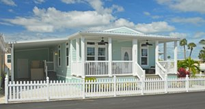 Green and White modular home at Ocean Breeze modular home community in Jensen Beach Florida