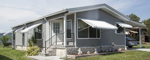 Manufactured Home on corner lot at Shadow Wood Village mobile Home Community in Hudson Florida