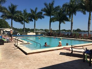 relaxing community pool with a water view at manufactured home community in Florida