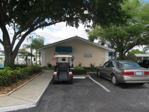 Golf cart parked at community clubhouse at Town & country gated 55+ community in Sebring, Florida