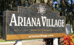 Entrance sign to Ariana Village